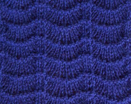 Navy blue background of soft, fleecy cloth. Texture of light dark denim nappy textile, closeup.