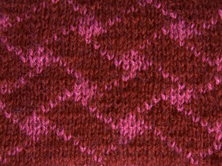 Red background of soft, fleecy cloth. Texture of nappy textile