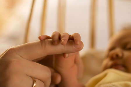 Mother's and baby's hands at the background kid face Stock Photo - 4723404