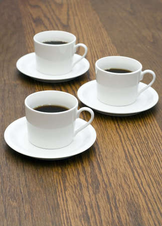 3 Coffee cups on wood table Stock Photo - 4687209