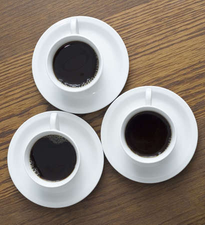 3 cup of coffee on wood table(photo from top) Stock Photo - 4687258