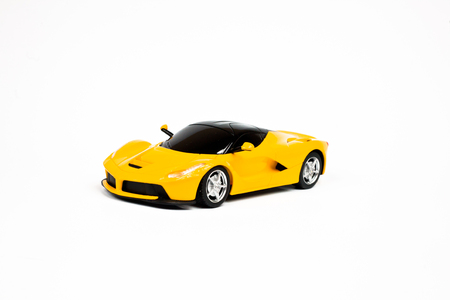 backgraound: Car toy on a whtie backgraound