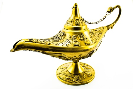 Aladdin`s magic genie lamp isolated on white