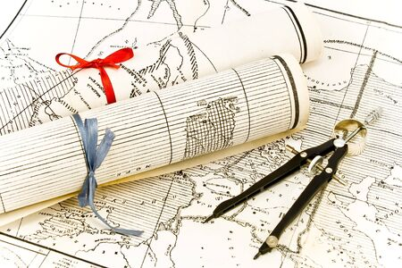 Olda Maps in rolls with ribbons and compass Stock Photo - 8764183