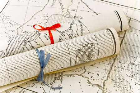 Olda Maps in rolls with colorful ribbons