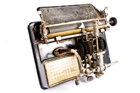 Ancient Typewriter isolated on white photo