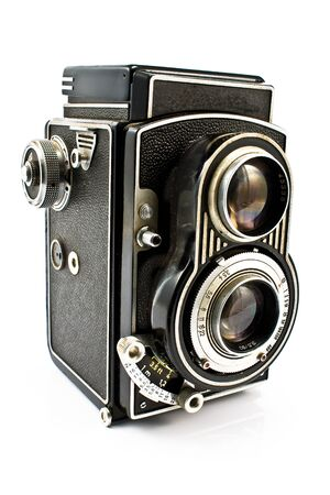 bakelite: Vintage two lens photo camera isolated on white