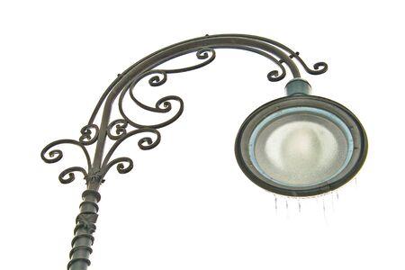Decorated iron street lantern on winter sky background Stock Photo - 9018171