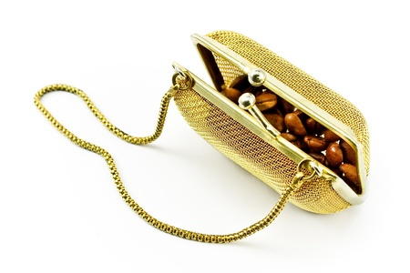 Golden metallic purse with coffee beans isolated on white photo