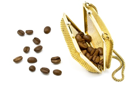 Gold  metallic purse with coffee beans isolated on white photo