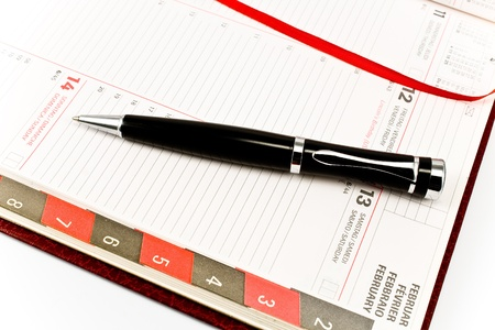 Pen on personal organizer isolated on white Stock Photo - 9112596