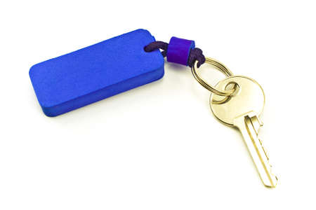 House key with blue tag isolated on white photo