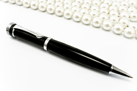 Pen with pearls in a background Stock Photo
