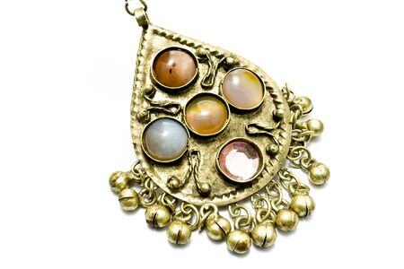 Antique necklace pendant with gems isolated on white