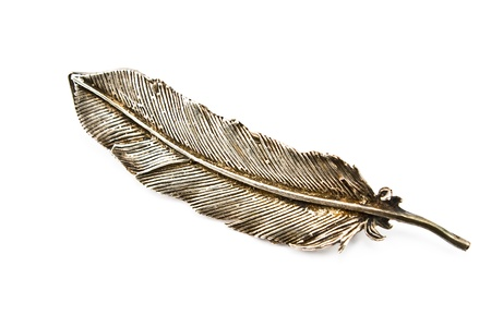 Old silver feather brooch isolated on white photo