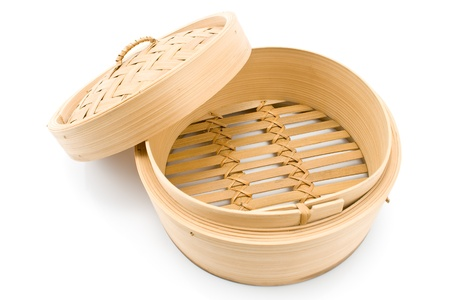 Bamboo  basket steamer with open lid isolated on white photo