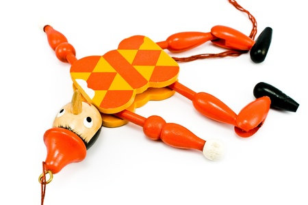 Lying Pinnochio mechanical toy isolated on white white Stock Photo - 9550549
