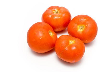 Four fresh tomatoes isolated on white Stock Photo - 9773755