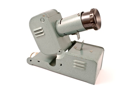 Old slide projector isolated on white photo