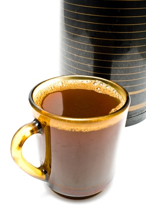 Cup of coffee  in front of thermos Stock Photo - 9873799