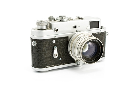 Vintage film photo camera isolated on white photo