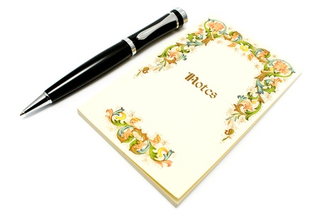 Yellow notebook and pen isolated on white Stock Photo - 9988688