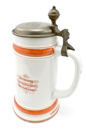 pewter mug: Porcelain Bavarian beer mug isolated on white