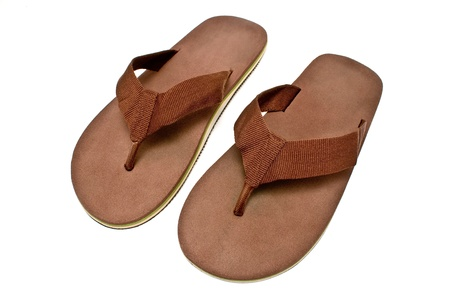 Pair of brown mens flip flop sandals isolated on white