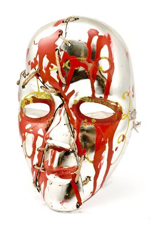 repaired: Broken and repaired carnival mask isolated on white
