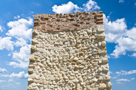 monolith: Stone monolith over blue sky with white clouds