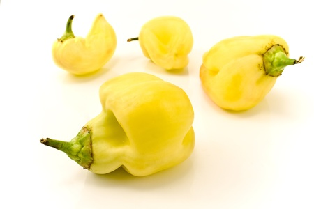 Deformed yellow paprika peppers on white background Stock Photo - 10407263
