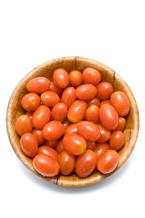 Plum tomatoes in wooden dish isolated on white Stock Photo - 10445602