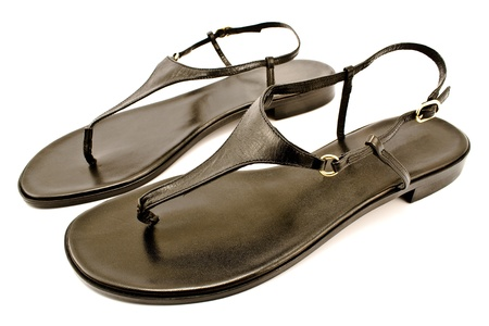 heel strap: Black leather womens sandal shoe isolated on white Stock Photo
