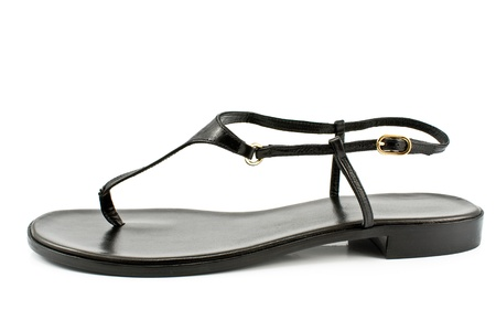 Black leather womens sandal shoe isolated on white Stock Photo