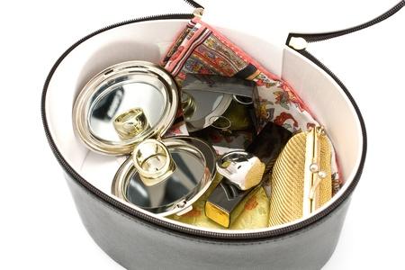 Inside of womens handbag isolated on white