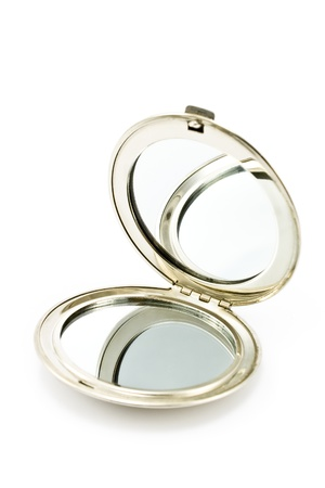 hands in pockets: Round pocket makeup mirror isolated on white