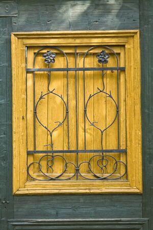 Old wooden door with metal ornaments  photo