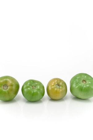 Four green tomatoes isolated on white Stock Photo - 10926895