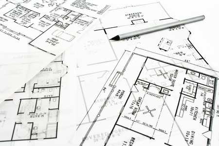 House plan blueprints with drawing pencil photo