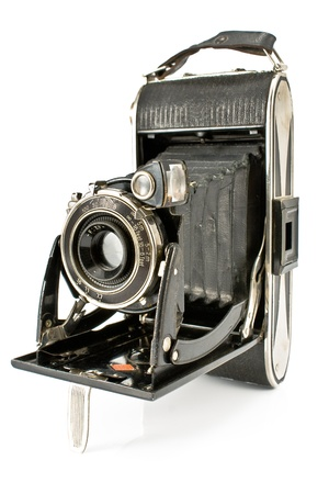 color photographs: Antique Old photo Camera isolated on white