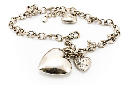 personal accessory: Silver necklace  with heart pendants isolated on white  Stock Photo