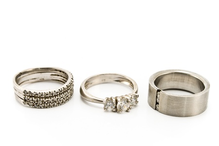 Three silver rings isolated on white photo