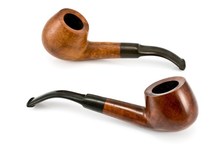 rich flavor: Two tobacco pipes  isolated on  white