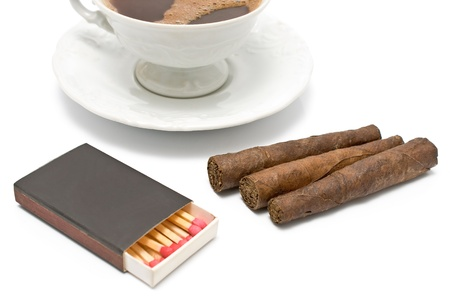 Cigars with matches and cup of coffee on white photo