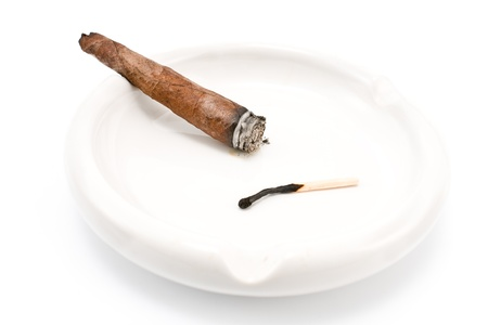 Smoking cigar in an ashtray isolated on  white photo