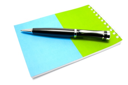Notepad and pen isolated on white photo