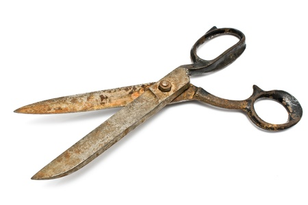 Old rusty sewing scissors isolated on white Stock Photo - 11855279