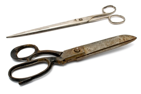 Two old rusty sewing scissors isolated on white photo
