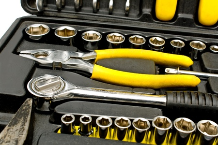 Set of various chrome yellow tools in box