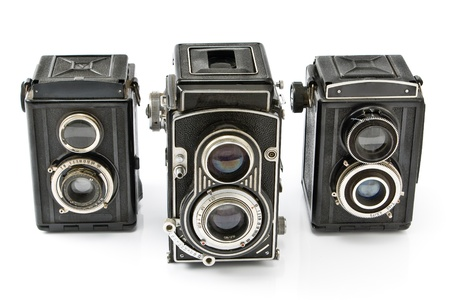 old items: Three Vintage two lens photo camera isolated on white Stock Photo